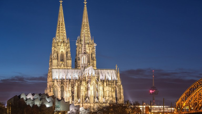 Visiting Cathedral in Cologne city by River Rhine
